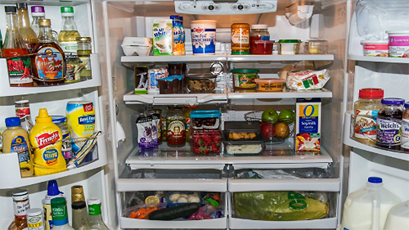 Picture of the inside of a full refrigerator