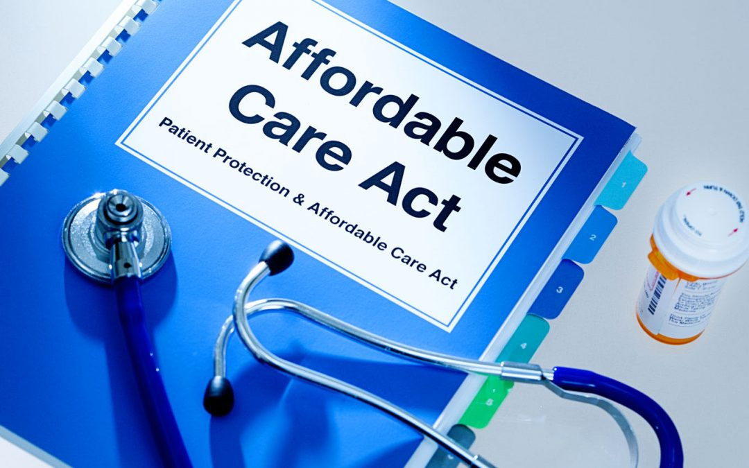 ACA Booklet with stethoscope and prescription pill bottle