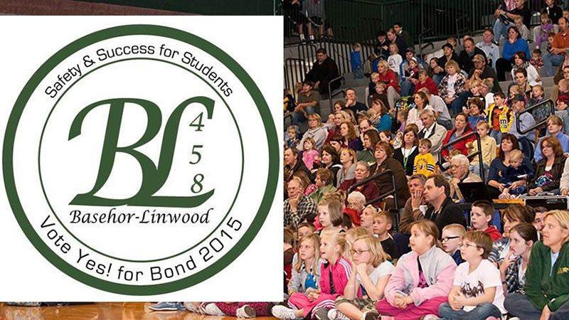 2015 USD 458 Bond Logo with students and parents in the background