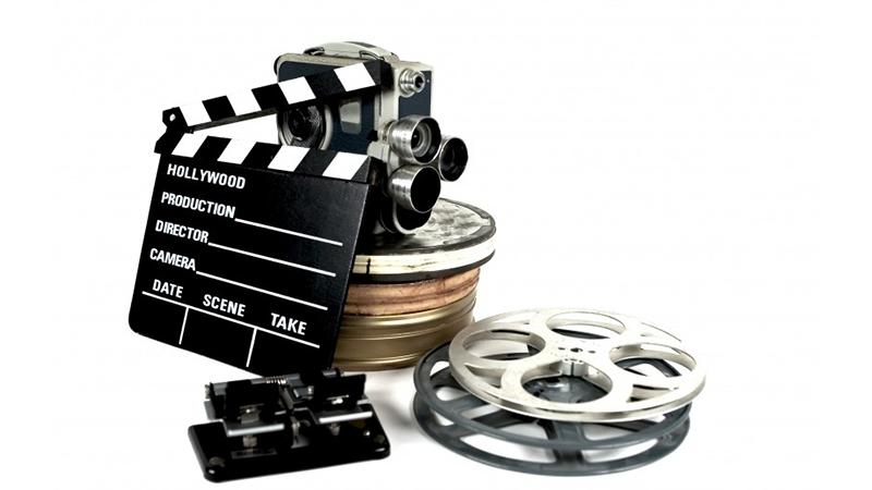 film reels, camera, slate, film cutter