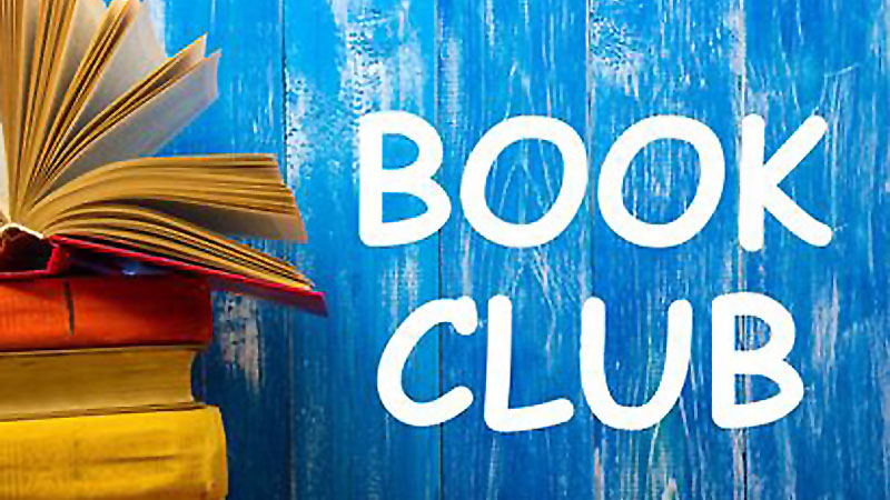Thursday Evening Book Club with books in front of blue painted wall