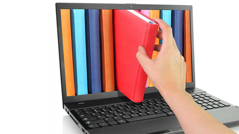 eLibrary - pulling a book out of a laptop screen
